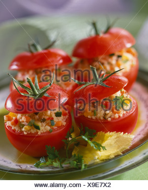 raw tomatoes stuffed with tabbouleh - Stock Photo