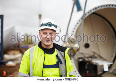 Portrait of engineer at wind farm - Stock Photo