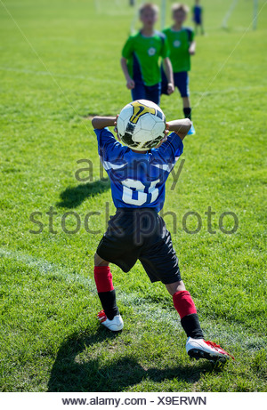 Throwin during youth soccer match. - Stock Photo