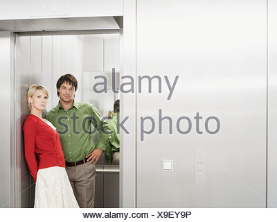 Portrait of two people in the lift - Stock Photo