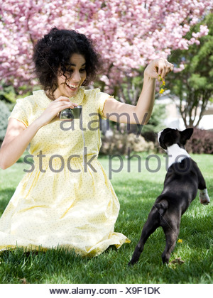 woman in a yellow dress taking photos - Stock Photo