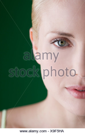 A portrait of a young blonde woman, left hand side of face - Stock Photo