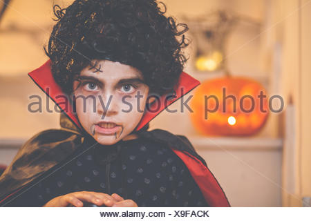 Portrait of a boy wearing a halloween dracula costume - Stock Photo