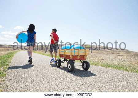 Children walking with balloons - Stock Photo