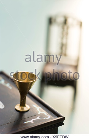 Miniature cup on table - Stock Photo