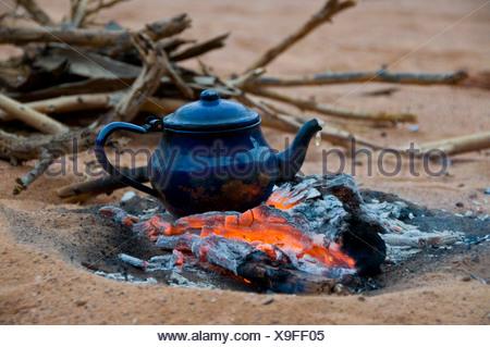 Pot of tea on a camp fire, Tadrat, Algeria, Africa - Stock Photo