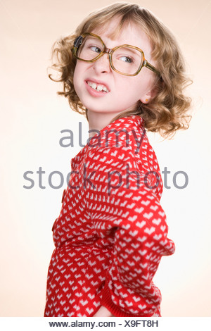 A geeky girl making faces - Stock Photo