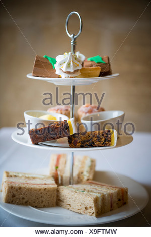 Afternoon tea and cakes. - Stock Photo