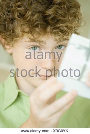 Boy holding up present - Stock Photo