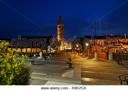 Caorle at the Adria region Veneto Italy chathedral with church tower - Stock Photo