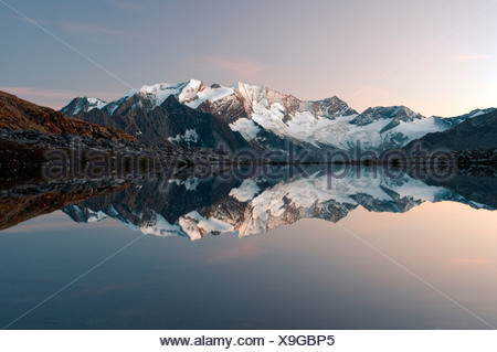 Hochfeiler Mountain reflected in Friesenbergrsee lake in Hochgebirgs Nature Park in the Zillertal Alps, Austria, Europe - Stock Photo