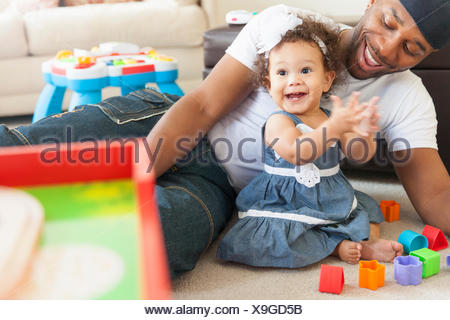 Father playing with young daughter - Stock Photo