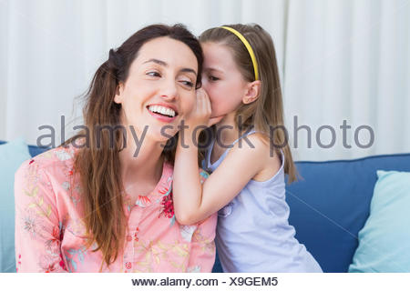 Mother and daughter sharing secrets - Stock Photo