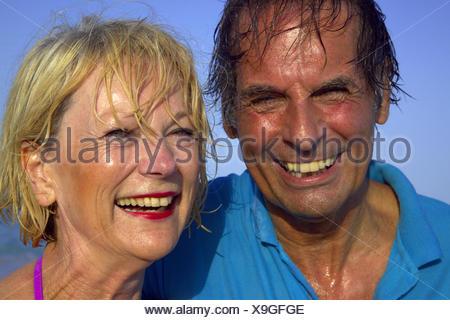 elderly married couple smiling, Balearen, Ibiza - Stock Photo