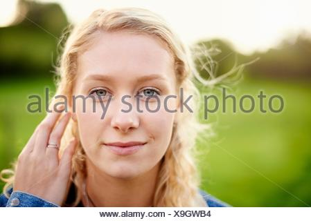 Close up portrait of young woman with blond hair - Stock Photo