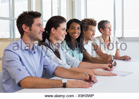 Casual business team having a meeting - Stock Photo
