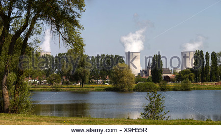 Two cooling towers of the French  Nuclear Power Plant, the church of  standing between the cooling towers, Lorraine region - Stock Photo