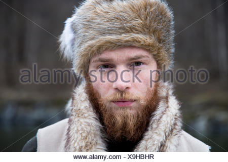 ... Mid adult man wearing trapper hat 81dfcc6f7991