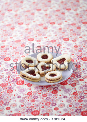 Jammy dodgers on a plate - Stock Photo