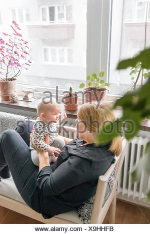 Sweden, Mother playing with baby boy (0-1 months) - Stock Photo