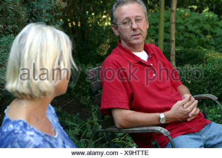 Couple quarrel in back garden - Stock Photo