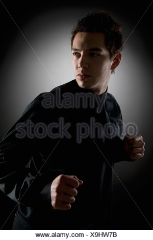 Man In Fighting Stance - Stock Photo