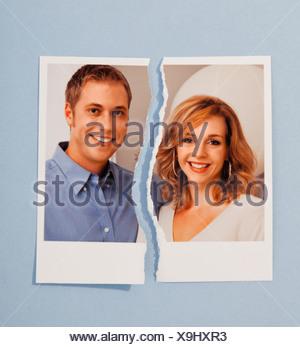 Studio shot of photo of couple torn in half - Stock Photo