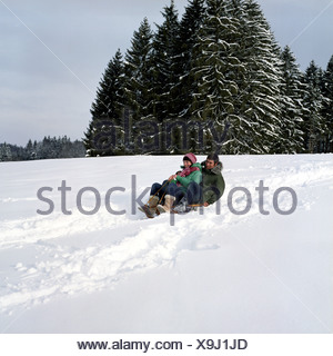 two teenagers sledging - Stock Photo