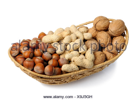 Set of nuts in a wicker basket, isolation - Stock Photo