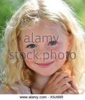 Little girl with blond hair, portrait, Sweden - Stock Photo