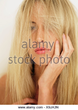 A woman with tousled hair, portrait - Stock Photo