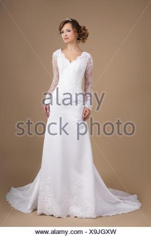 Graceful Exquisite Auburn Bride in Wedding Dress - Stock Photo