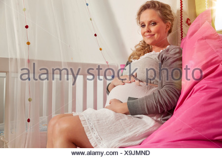 Cool Germany Bonn Pregnant Woman Sitting On Bean Bag Smiling Beatyapartments Chair Design Images Beatyapartmentscom