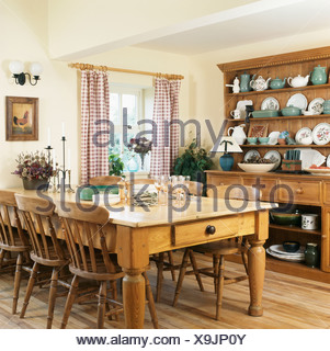 Pine Table And Chairs Large Dresser In Country Kitchen With Red Checked Curtains On