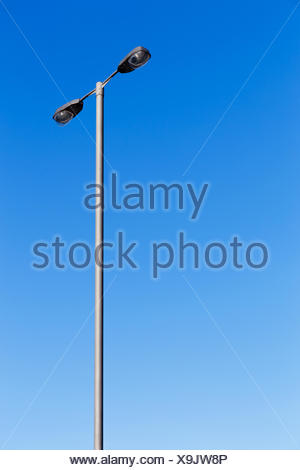 blue shine shines bright lucent light serene luminous sunny energy power electricity electric power lamppost metal outdoor pole - Stock Photo
