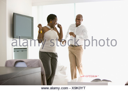 Couple dancing in living room - Stock Photo