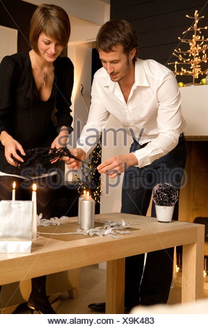 Mid adult man and a young woman celebrating Christmas - Stock Photo