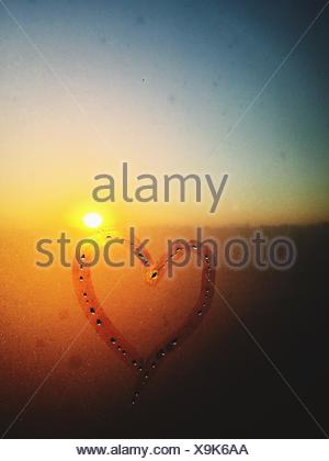 Heart Drawn On Condensed Window - Stock Photo