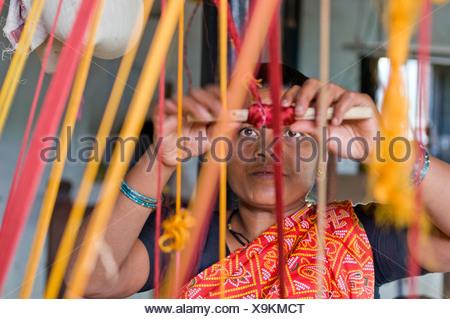 Weaver weaving, Ahilya Fort, Maheshwar, Madhya Pradesh, India, Asia - Stock Photo