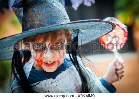 Boy (8-9) with scary costume for Halloween - Stock Photo