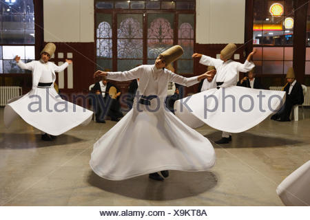 Whirling Dervishes dancing the Sema, a Dervish dance, Sirkeci Railway Station, Istanbul, Turkey, Europe, Istanbul - Stock Photo