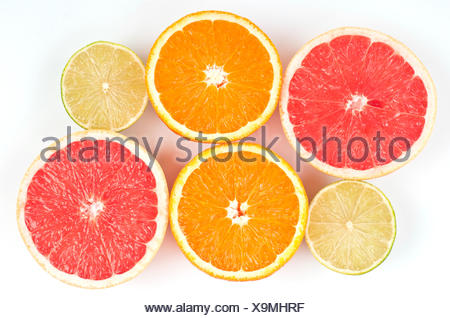 Lime, orange and pink grapefruit slices - Stock Photo