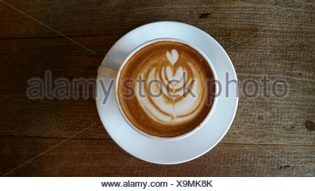 Directly Above View Of Coffee With Latte Art On Table - Stock Photo
