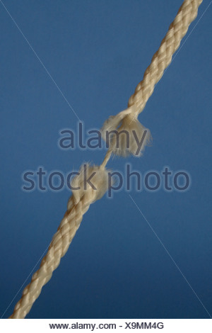 Rope hanging by a thread - Stock Photo