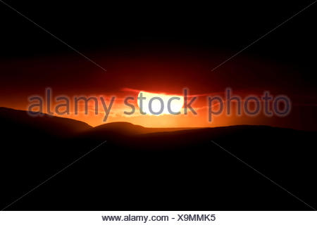 Sunset behind the ash and gas cloud of the Holuhraun fissure eruption, near the volcano Bárðarbunga, highlands - Stock Photo