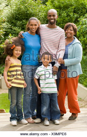 Three generation family in garden - Stock Photo