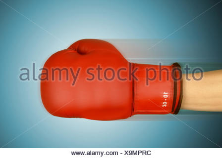 Red boxing glove with the blow, - Stock Photo