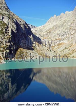 alps hike go hiking ramble mirroring mountain lake mountain migrate - Stock Photo