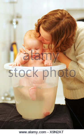 Baby bathed in Baby Bath - Stock Photo