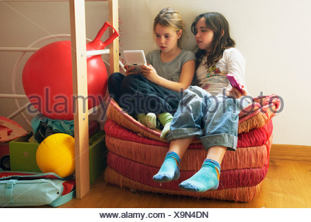 Two girls playing computer game - Stock Photo